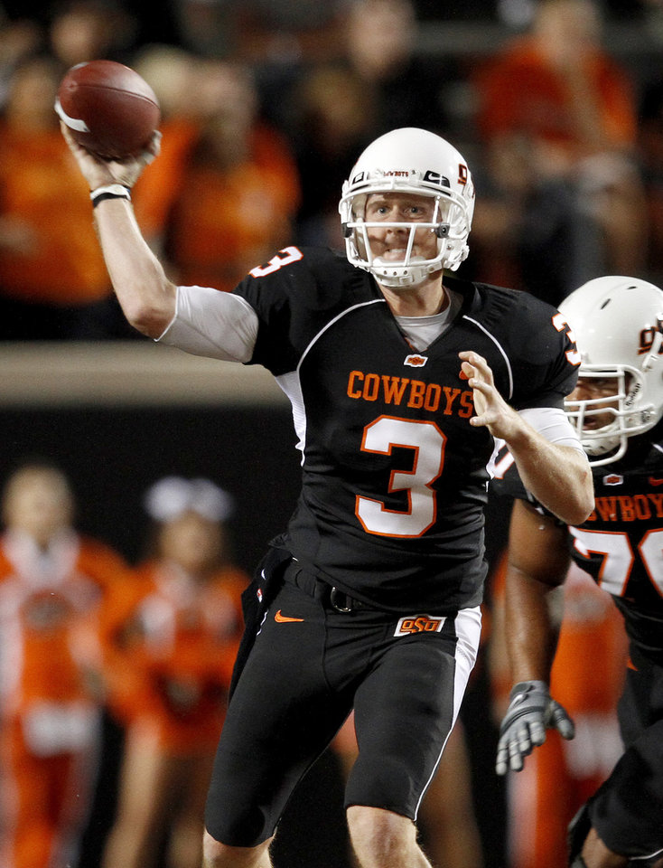Photo - OSU's Brandon Weeden throws a pass during the college football game between Texas A&M University and Oklahoma State University (OSU) at Boone Pickens Stadium in Stillwater, Okla., Thursday, Sept. 30, 2010. Photo by Bryan Terry, The Oklahoman