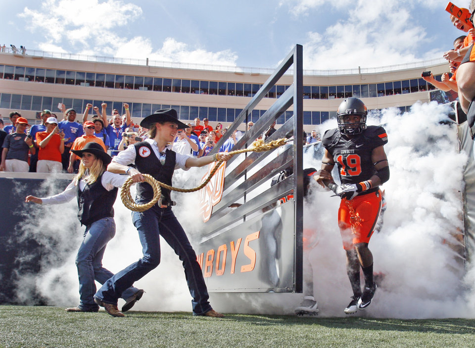 Photo - Cowboys enter for field for the football game between the Oklahoma State University Cowboys (OSU) and the University of Kansas Jayhawks (KU) at Boone Pickens Stadium in Stillwater, Okla., Saturday, Oct. 8, 2011 Photo by Steve Sisney, The Oklahoman