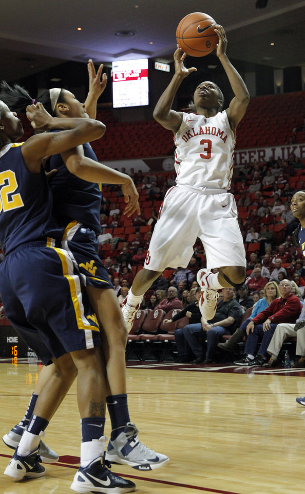 Photo - Oklahoma Sooner's Aaryn Ellenberg (3) shoots in front of West Virginia Mountaineers' Crystal Leary (32) and Akilah Bethel (3) as the University of Oklahoma Sooners (OU) play the West Virginia Mountaineers in NCAA, women's college basketball at The Lloyd Noble Center on Wednesday, Jan. 2, 2013  in Norman, Okla. Photo by Steve Sisney, The Oklahoman