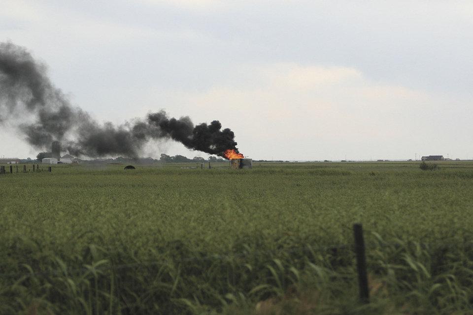 Photo - An oil tank battery caught fire in Union City Friday morning when it was hit by lightning  Emily Kindiger, El Reno Tribune. - Emily Kindiger, El Reno Tribune.