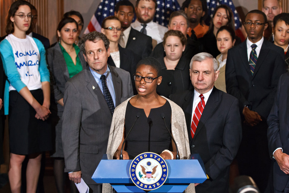Photo -   Clarise McCants of Philadelphia, a Howard University political science major, center, flanked by Sen. Sherrod Brown, D-Ohio, left, and Sen. Jack Reed, D-R.I., right, and accompanied by students, speaks during a news conference on Capitol Hill in Washington, Tuesday, May 8, 2012, as the Senate moves toward a showdown on a Democratic proposal to keep federally subsidized loan interest rates from doubling for millions of college students. (AP Photo/J. Scott Applewhite)