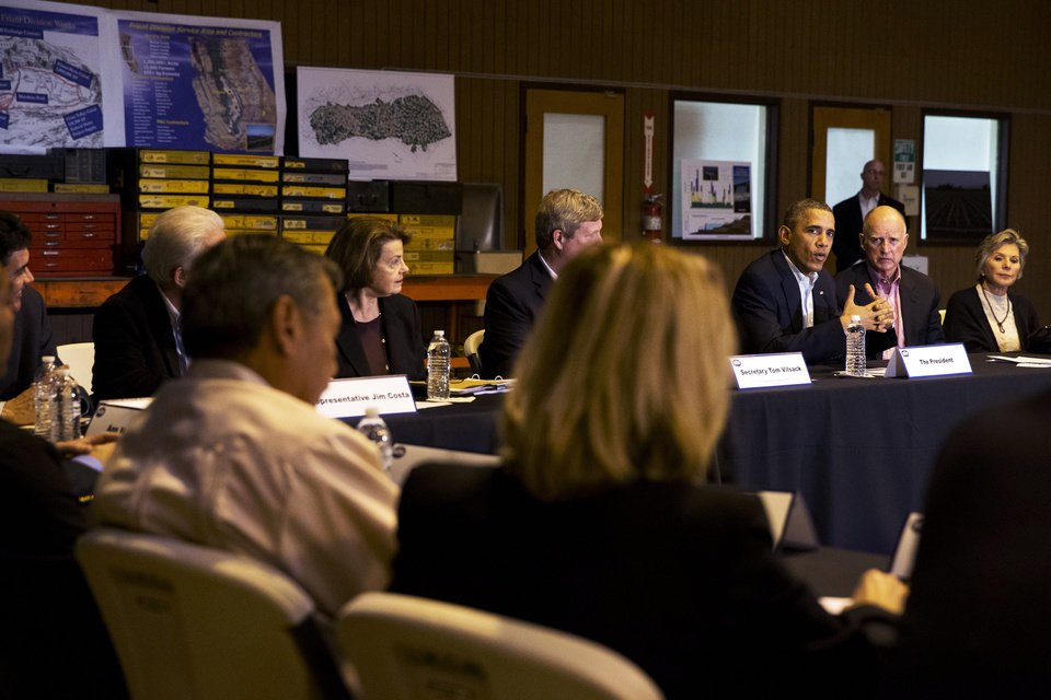 Photo - President Barack Obama, third from left, speaks during a roundtable with community leaders including California Gov. Jerry Brown, and Sen. Barbara Boxer, D-Calif., right, at San Luis Water Facility in Firebaugh, Calif., Friday, Feb. 14, 2014, regarding the ongoing drought.  (AP Photo/Jacquelyn Martin)