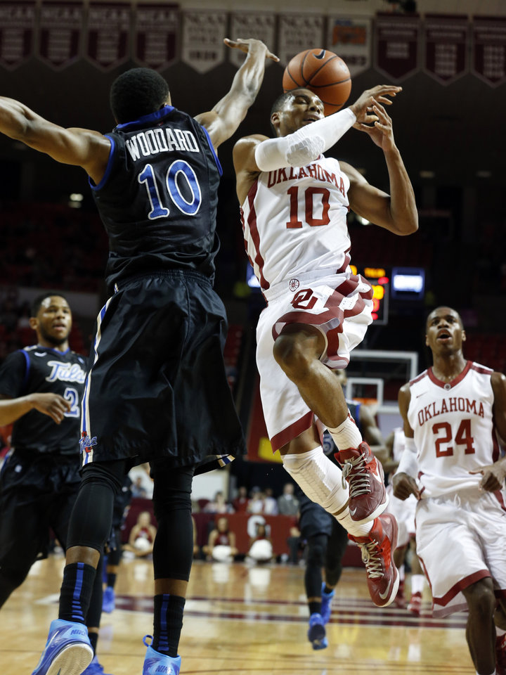 Tulsa's James Woodard (10) fouls his brother Oklahoma's Jordan Woodard (10) on a shot as the University of Oklahoma Sooners (OU) men play the Tulsa Golden Hurricane in NCAA, college basketball at The Lloyd Noble Center on Saturday, Dec. 14, 2013  in Norman, Okla. Photo by Steve Sisney, The Oklahoman