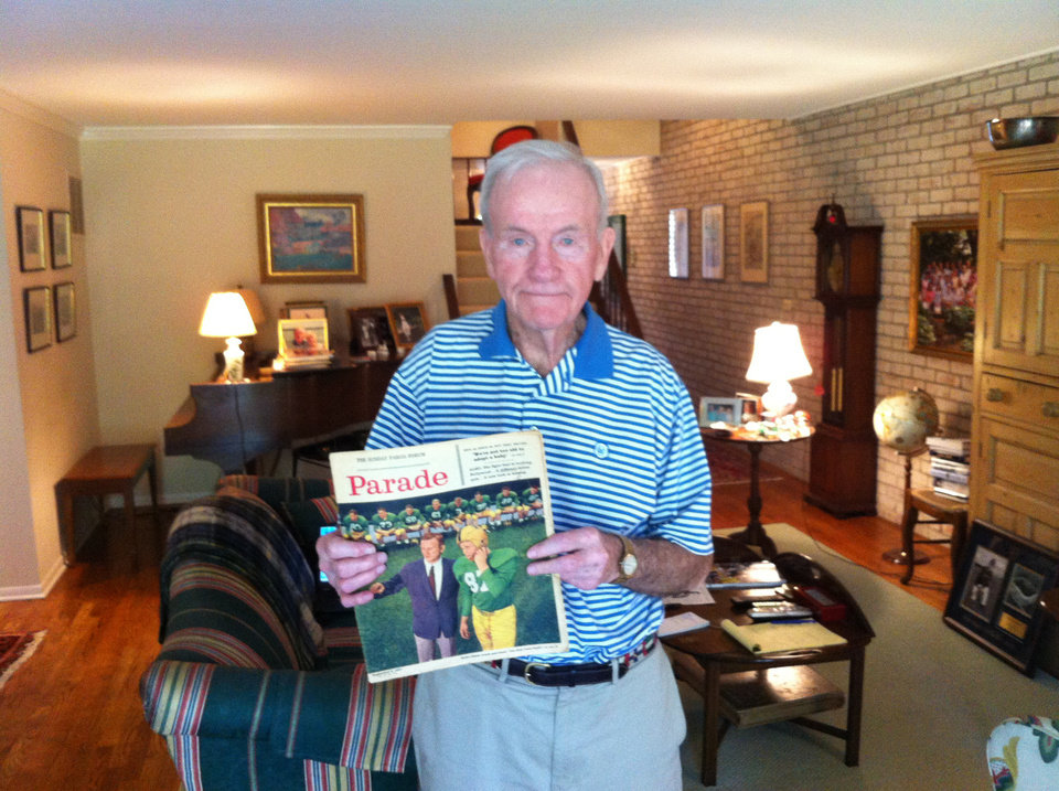 Photo - Former Notre Dame football coach Terry Brennan shows off a 1957 Parade magazine cover that featured him. Photo by Berry Tramel, The Oklahoman