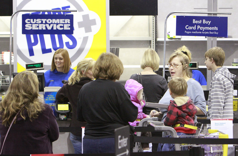 Shoppers return merchandise at the Best Buy on Memorial, Monday, December 26, 2011. Photo by David McDaniel, The Oklahoman