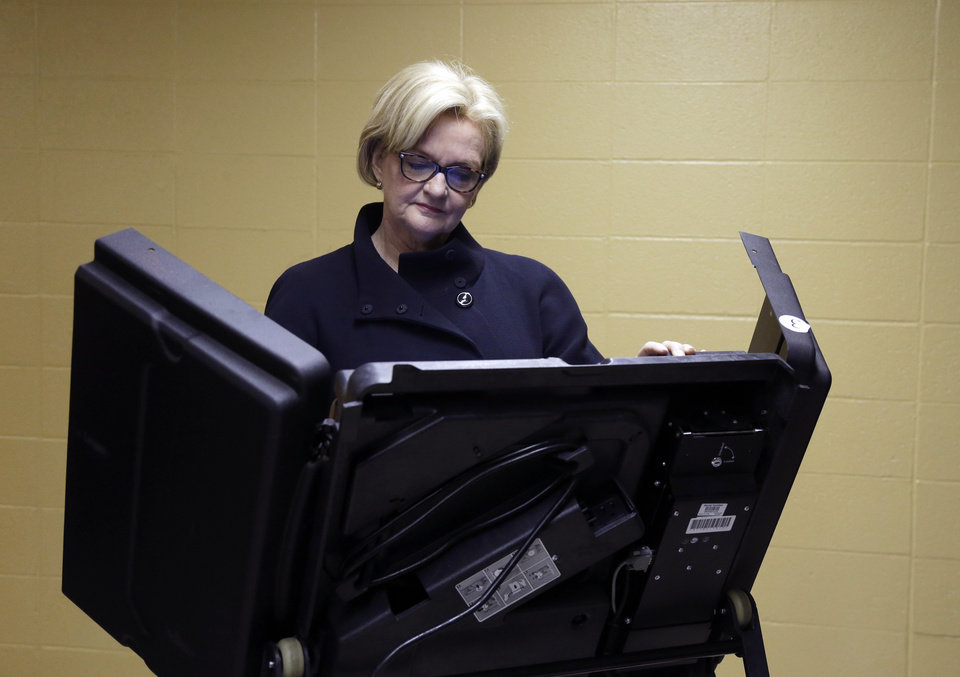 Photo -   U.S. Sen. Claire McCaskill, D-Mo., votes at her polling place, Kirkwood Community Center, Tuesday, Nov. 6, 2012, in Kirkwood, Mo. McCaskill is running for reelection against Republican challenger Rep. Todd Akin, R-Mo. (AP Photo/Jeff Roberson)