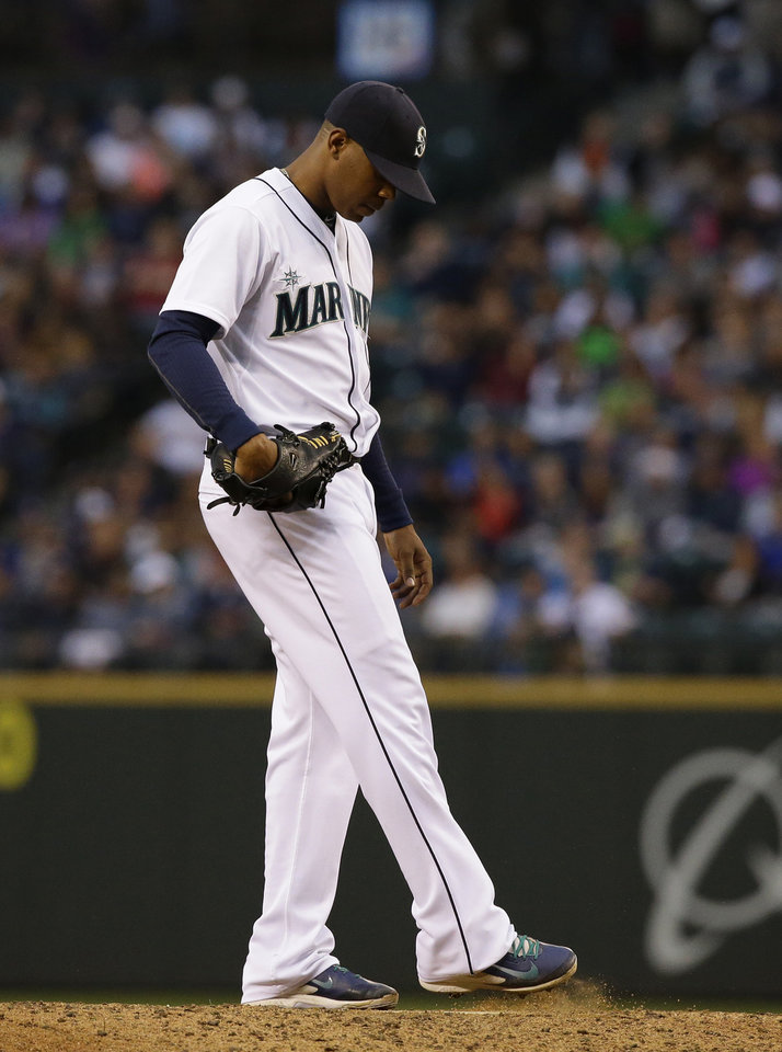 Photo - Seattle Mariners starting pitcher Roenis Elias kicks dirt on the mound during the fifth inning of a baseball game against the Washington Nationals, Saturday, Aug. 30, 2014, in Seattle. (AP Photo/Ted S. Warren)
