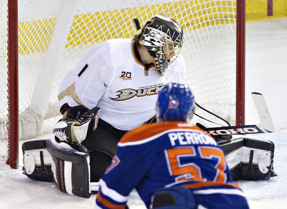 Photo - Anaheim Ducks goalie Jonas Hiller (1) is scored on by Edmonton Oilers David Perron (57) during second period NHL hockey action in Edmonton,  Alberta, on Sunday April 6, 2014. (AP Photo/The Canadian Press, Jason Franson)