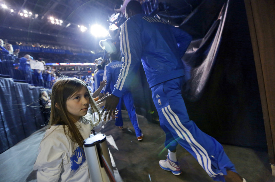 Fans greet the players as they enter the court during the season finally NBA basketball game between the Oklahoma City Thunder and the Milwaukee Bucks at Chesapeake Energy Arena on Wednesday, April 17, 2013, in Oklahoma City, Okla.   Photo by Chris Landsberger, The Oklahoman