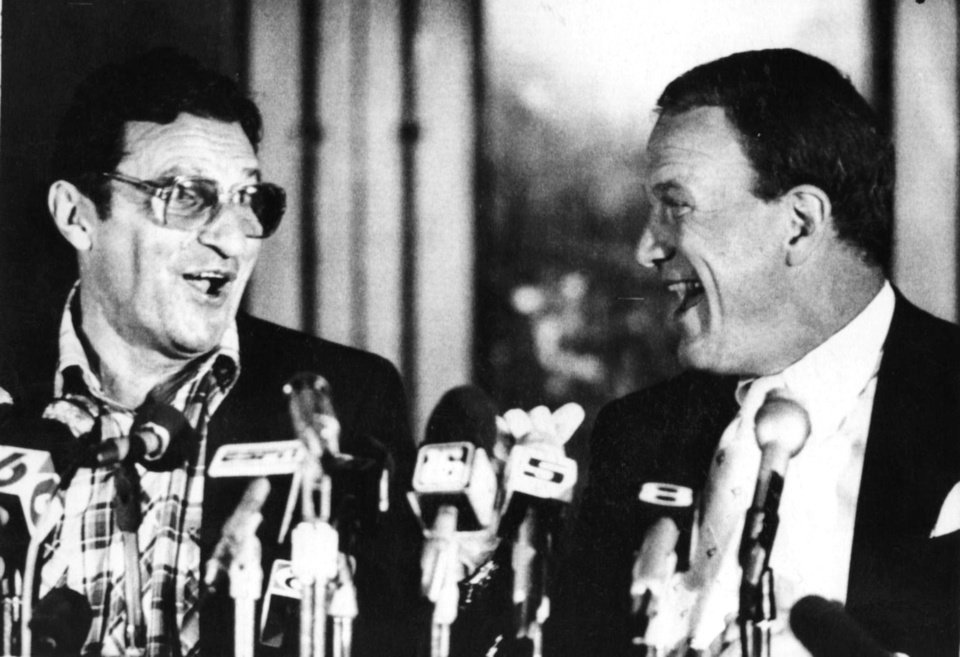 Penn State football coach Joe Paterno, left, and University of Oklahoma football coach Barry Switzer share a laugh before the 1985 Orange Bowl. OKLAHOMA ARCHIVE PHOTO