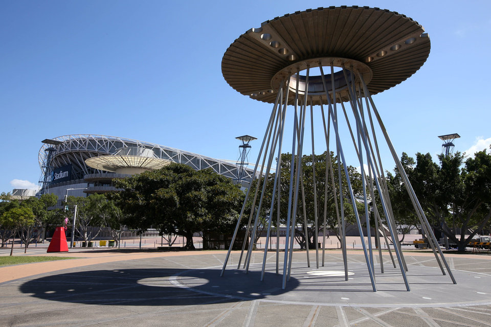 Photo - The Sydney Olympic Cauldron stands across from the Olympic Stadium in Sydney, Monday, Feb. 24, 2014. Before the 2000 summer Olympics, the site west of Sydney where the 1580-acre Sydney Olympic Park was built was a grungy, desolate wasteland of slaughterhouses, garbage dumps and factories. Since the games, it has slowly developed into its own suburb with hotels, offices, restaurants and parklands. The park now hosts thousands of events each year, from music festivals to sports to business conferences, drawing more than 12 million annual visitors. (AP Photo/Rick Rycroft)