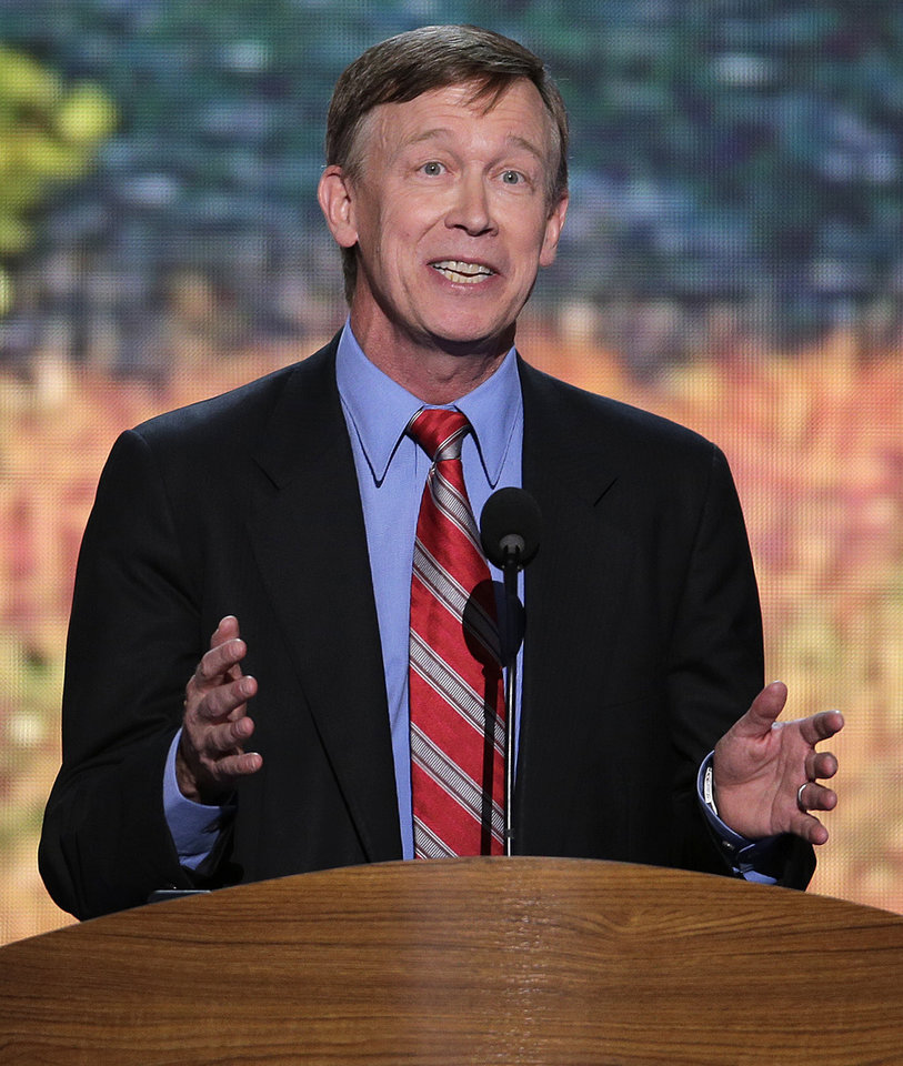 Photo - Colorado Gov. John Hickenlooper addresses the Democratic National Convention in Charlotte, N.C., on Wednesday, Sept. 5, 2012. (AP Photo/J. Scott Applewhite)  ORG XMIT: DNC152
