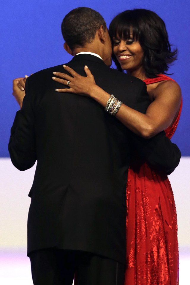 Photo - President Barack Obama and first lady Michelle Obama dance together at the Commander-in-Chief Inaugural Ball in Washington, at the Washington Convention Center during the 57th Presidential Inauguration Monday, Jan. 21, 2013. (AP Photo/Jacquelyn Martin)
