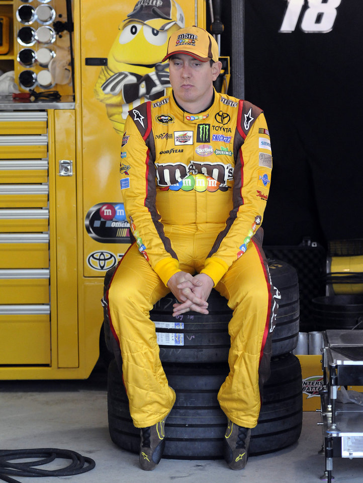 Photo - Kyle Busch waits in the garage for the first round of qualifying for Sunday's NASCAR Sprint Cup Series auto race, at Martinsville Speedway in Martinsville, Va., Friday, March 28, 2014. (AP Photo/Mike McCarn)