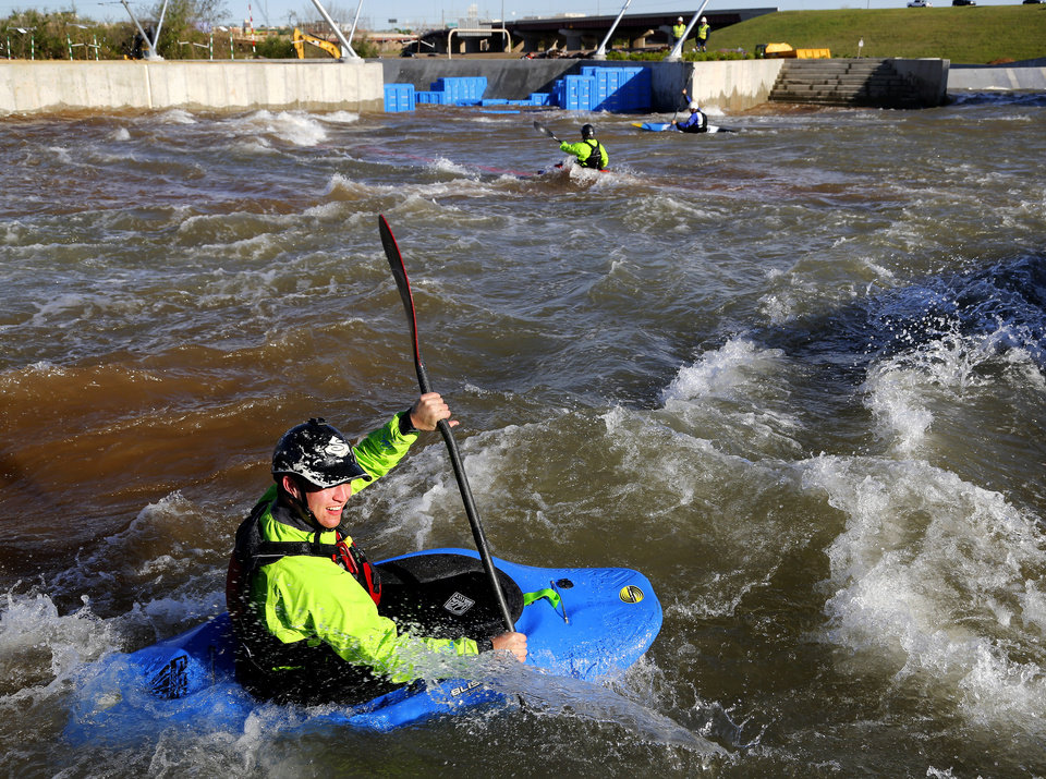 Photo -  A kayaker maneuvers his way through the Riversport Rapids, the whitewater rafting and kayaking park in the Oklahoma City Boathouse District. [Photo by Jim Beckel, The Oklahoman Archives]
