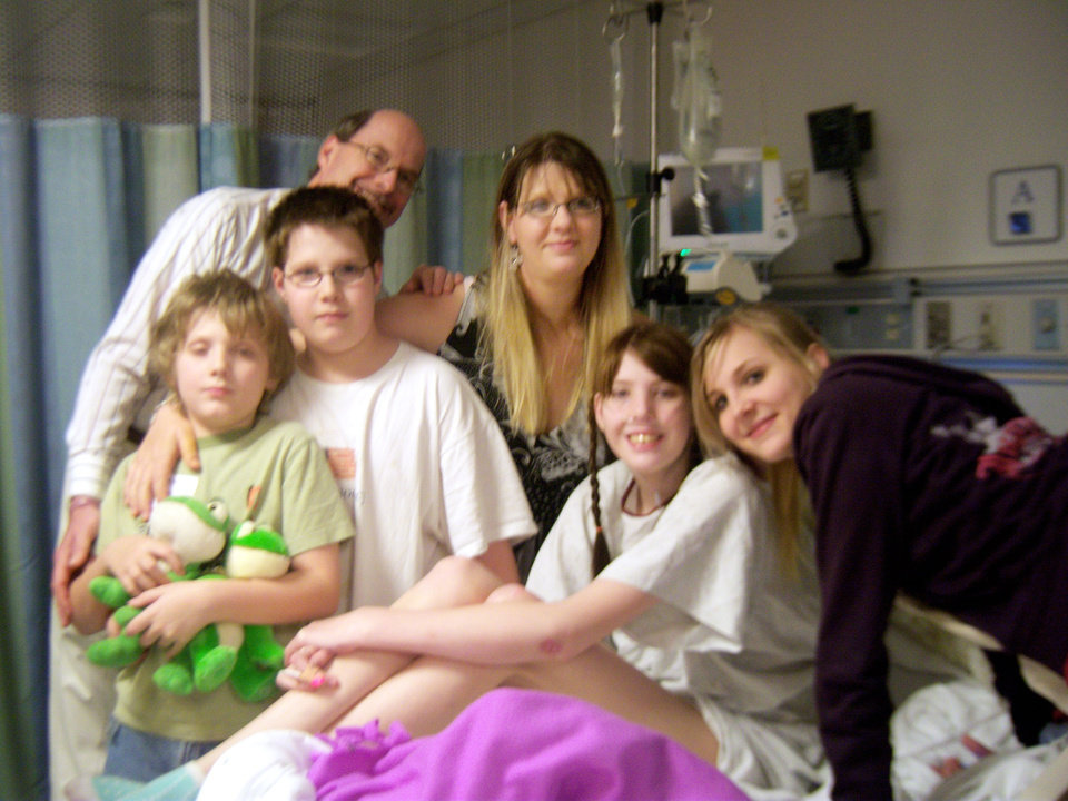 Photo - SAM ULRICH, ANDREW ULRICH, JOHN ULRICH, LESA ULRICH, ASHTON ULRICH: Cystic fibrosis patient Jordan Ulrich, 17, visits with her family minutes before heading to the operating room for her double-lung transplant on May 10. The Ulrich family, from left: Sam, 9; Andrew, 11; John; Lesa; Jordan and Ashton, 16. Photo Provided by Lesa Ulrich ORG XMIT: KOD