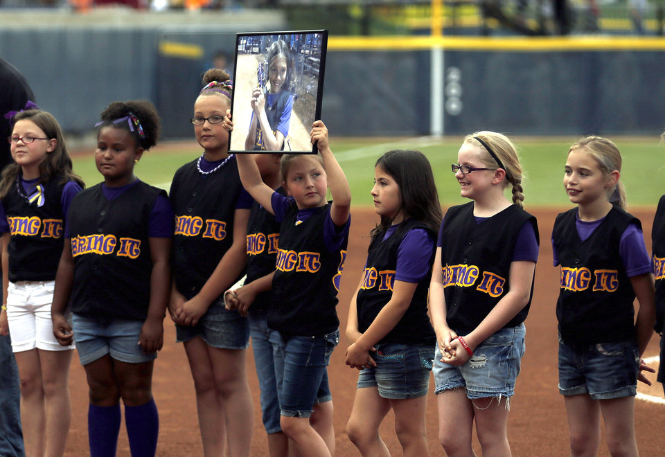 Sydney Angles youth team is introduced before the Women's College World Series softball game between Oklahoma and Tennessee at ASA Hall of Fame Stadium in Oklahoma City,Tuesday, June, 4, 2013. Photo by Sarah Phipps, The Oklahoman
