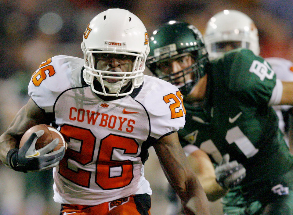 OSU's Quinton Moore (26) runs past Baylor quarterback Blake Szymanski after Moore intercepted a Symaski pass in the second half during the college football game between Oklahoma State University and Baylor University at Floyd Casey Stadium in Waco, Texas, Saturday, Nov. 17, 2007. BY MATT STRASEN, THE OKLAHOMAN