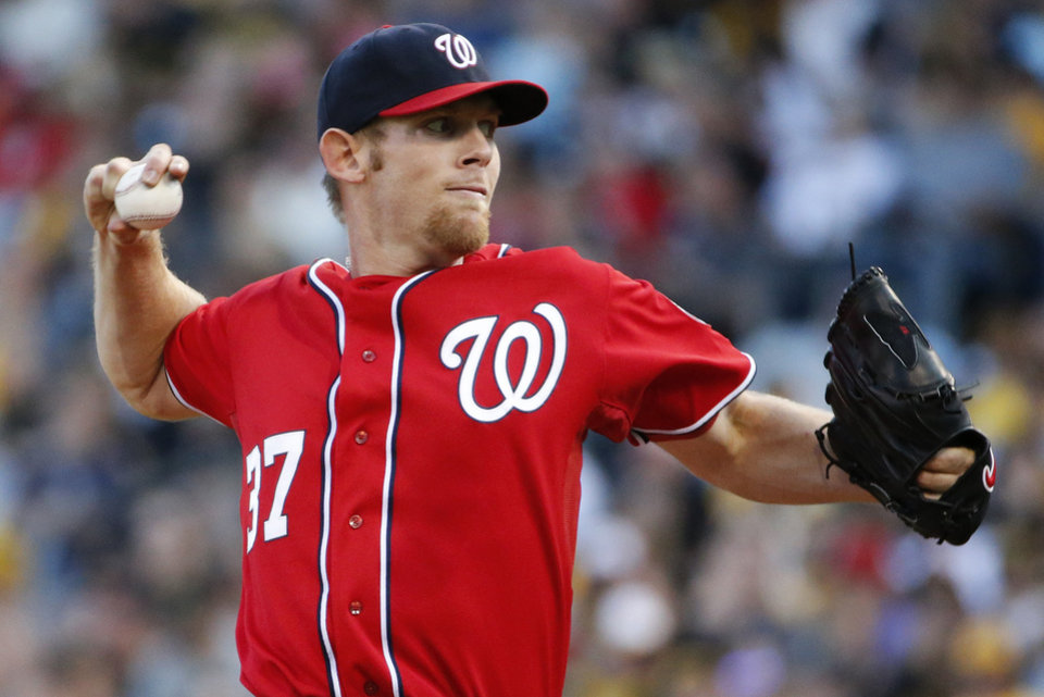 Photo - Washington Nationals starting pitcher Stephen Strasburg delivers during the first inning of a baseball game against the Pittsburgh Pirates in Pittsburgh, Saturday, May 24, 2014. (AP Photo/Gene J. Puskar)