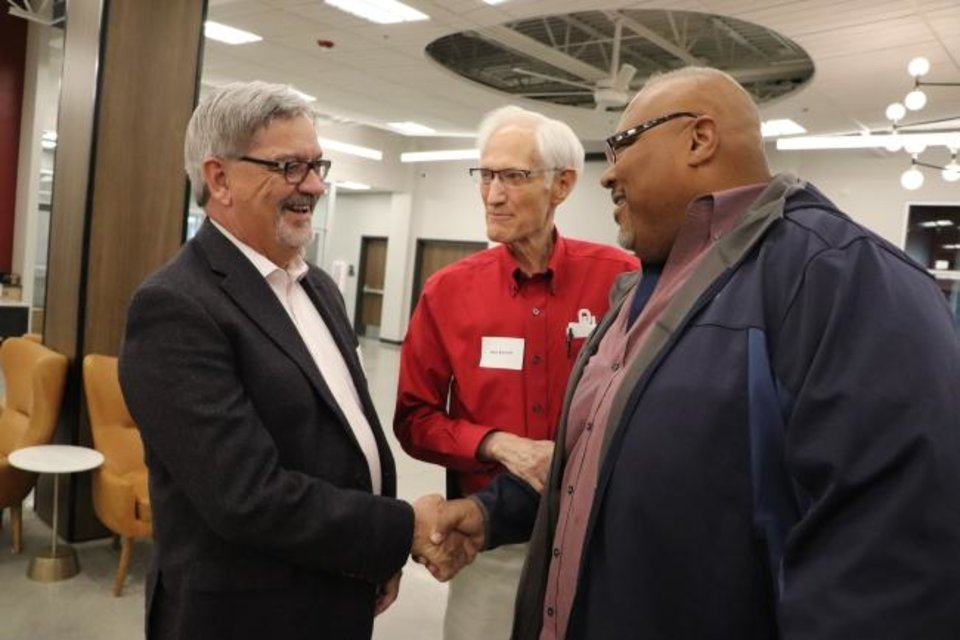 Photo -  The Rev. Joe Ligon, senior associate executive director of the Baptist General Convention of Oklahoma, talks with Max Barnett, former University of Oklahoma Baptist Student Union director, and Emmitt Greene, a 1980s OU alum and BSU participant, at the dedication of the new BCM building at OU. [Baptist Messenger]