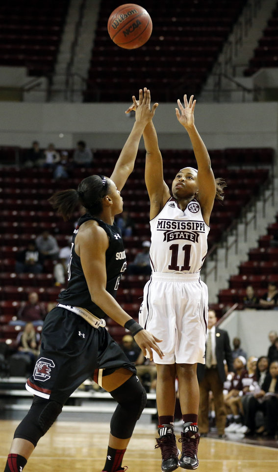 Photo - Mississippi State guard Katia May (11) attempts a shot as South Carolina guard Tiffany Mitchell (25) defends in the first half of an NCAA college basketball game in Starkville, Miss., Thursday, Feb. 6, 2014. (AP Photo/Rogelio V. Solis)