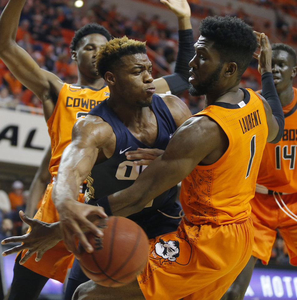 Photo - Oklahoma State's Jonathan Laurent (1) defends Elijah Lufile (1) of Oral Roberts during an NCAA basketball game between the Oklahoma State University Cowboys (OSU) and the Oral Roberts Golden Eagles (ORU) at Gallagher-Iba Arena in Stillwater, Okla., Wednesday, Nov. 6, 2019. Oklahoma State won 80-75. [Bryan Terry/The Oklahoman]