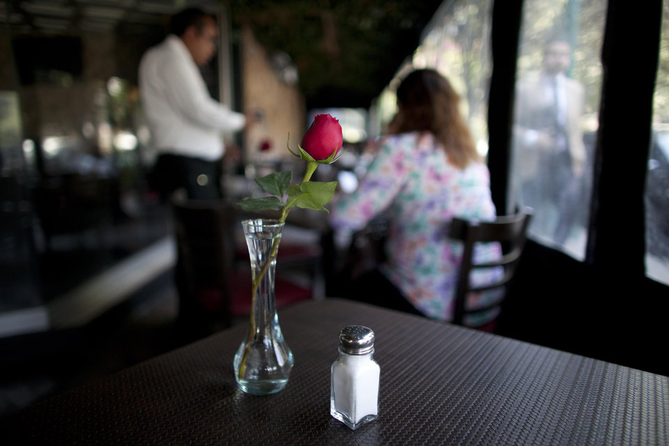 "In this April 9, 2013 photo, a salt shaker sits on a table in a restaurant in Mexico City. The country's Health Secretary Armando Ahued launched a campaign, dubbed ""Less Salt, More Health,"" to get restaurants to take salt shakers off their tables. Officials and the city's restaurant chamber signed an agreement to encourage eateries to provide shakers only if guests ask for them. The program is voluntary but the chamber is urging its members to comply. (AP Photo/Alexandre Meneghini)"