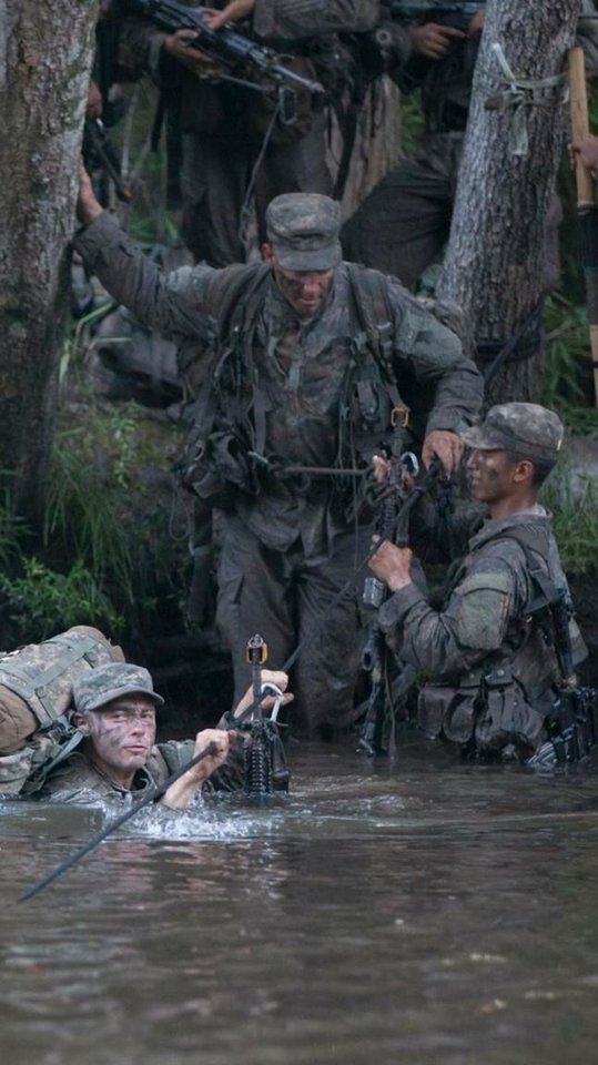 Photo -  Matt Meloni enters a river for crossing during Ranger School. [Photo provided]