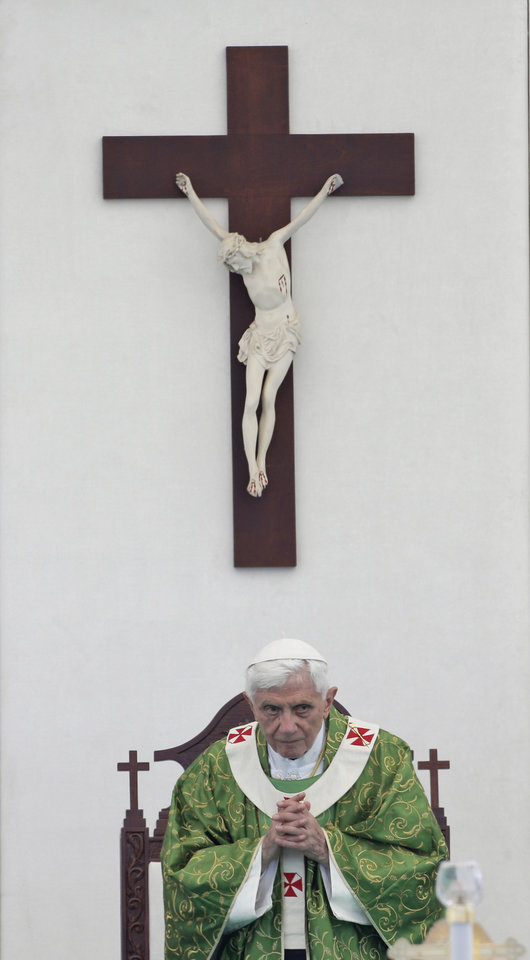 Photo -   Pope Benedict XVI prays during a mass on the waterfront in Beirut, Lebanon, Sunday, Sept. 16, 2012. The Pope celebrated an open-air Mass for tens of thousands of pilgrims from across the Middle East, saying Christians must do their part to end the