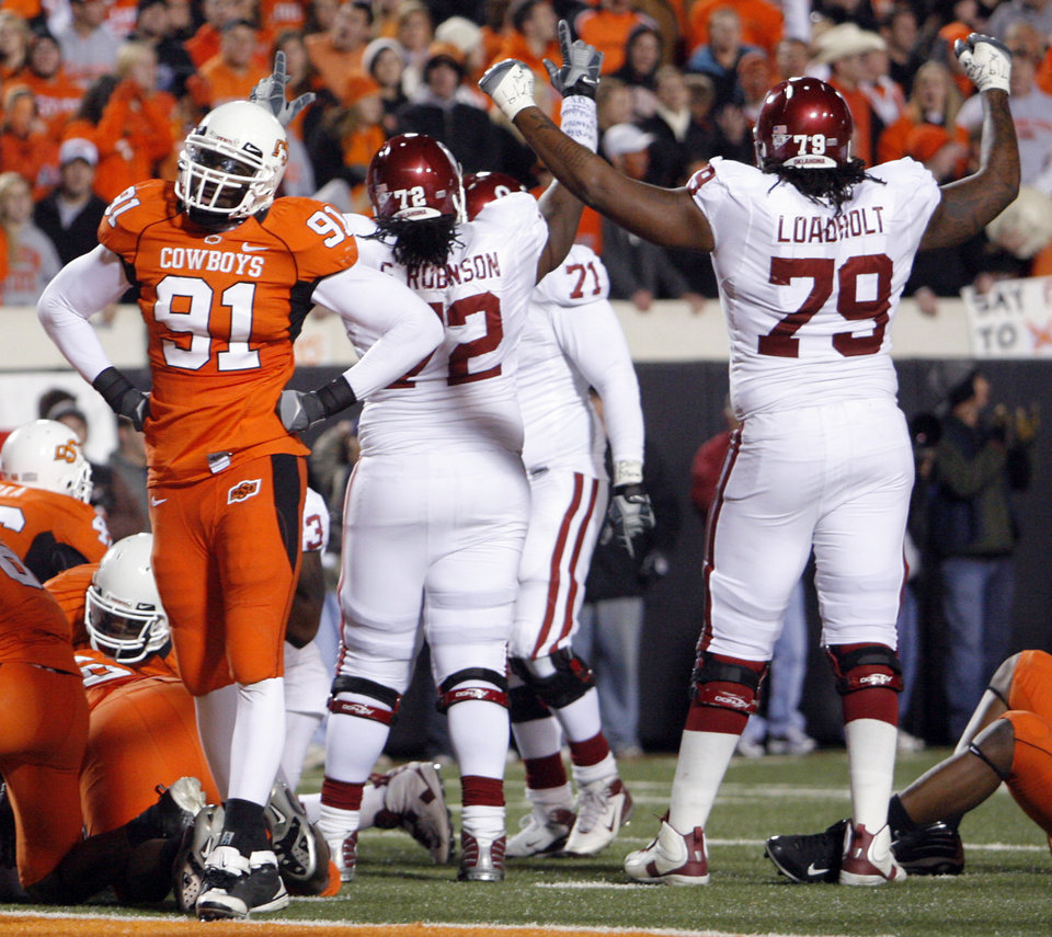 Photo - Oklahoma State's Ugo Chinasa (91) reacts after an Oklahoma touchdown during the second half of the college football game between the University of Oklahoma Sooners (OU) and Oklahoma State University Cowboys (OSU) at Boone Pickens Stadium on Saturday, Nov. 29, 2008, in Stillwater, Okla. STAFF PHOTO BY CHRIS LANDSBERGER