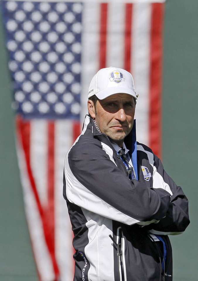 Photo - European team captain Jose Maria Olazabal watches drives on the first tee during a singles match at the Ryder Cup PGA golf tournament Sunday, Sept. 30, 2012, at the Medinah Country Club in Medinah, Ill. (AP Photo/Charles Rex Arbogast)  ORG XMIT: PGA140