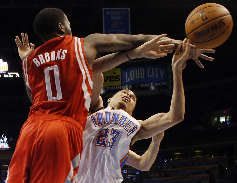 Oklahoma City\'s Kevin Martin (23) collides with Houston\'s Aaron Brooks (0) during Game 1 in the first round of the NBA playoffs between the Oklahoma City Thunder and the Houston Rockets at Chesapeake Energy Arena in Oklahoma City, Sunday, April 21, 2013. Oklahoma City won, 120-91. Photo by Nate Billings, The Oklahoman