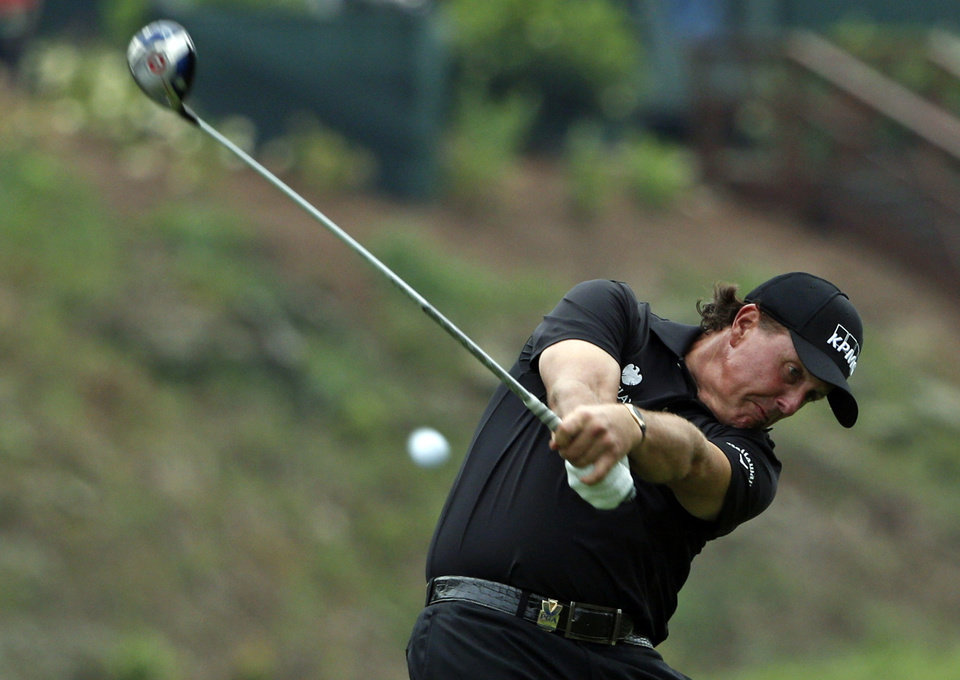 Photo - Phil Mickelson hits his tee shot on the 15th hole during the second round of the PGA Championship golf tournament at Valhalla Golf Club on Friday, Aug. 8, 2014, in Louisville, Ky. (AP Photo/Mike Groll)