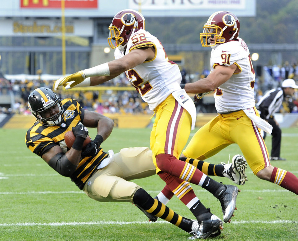 Photo -   Pittsburgh Steelers tight end Leonard Pope (45) gets hit by Washington Redskins linebacker Keenan Robinson (52) as he gets into the end zone after catching a pass for a touchdown in the first quarter during an NFL football game on Sunday, Oct. 28, 2012, in Pittsburgh. (AP Photo/Don Wright)