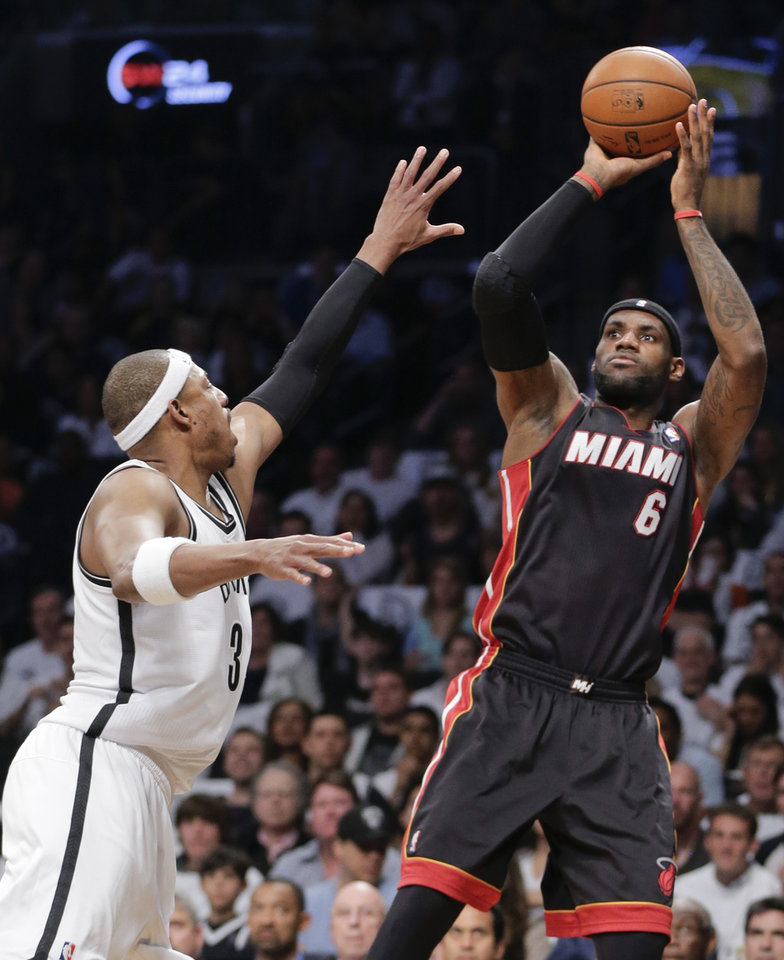 Photo - Miami Heat forward LeBron James (6) shoots against Brooklyn Nets forward Paul Pierce in the first period during Game 3 of an Eastern Conference semifinal NBA playoff basketball game on Saturday, May 10, 2014, in New York. (AP Photo/Julie Jacobson)