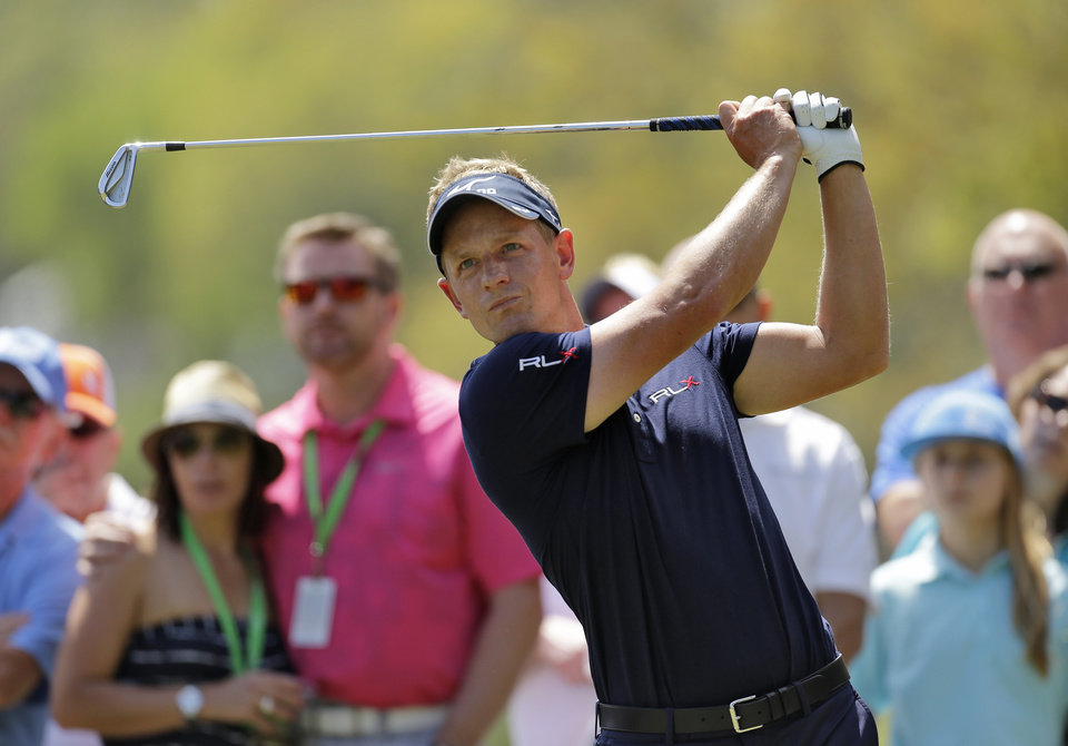 Photo - Luke Donald, of England, hits his tee shot on the second hole during the final round of the Valspar Championship golf tournament at Innisbrook, Sunday, March 16, 2014, in Palm Harbor, Fla. (AP Photo/Chris O'Meara)
