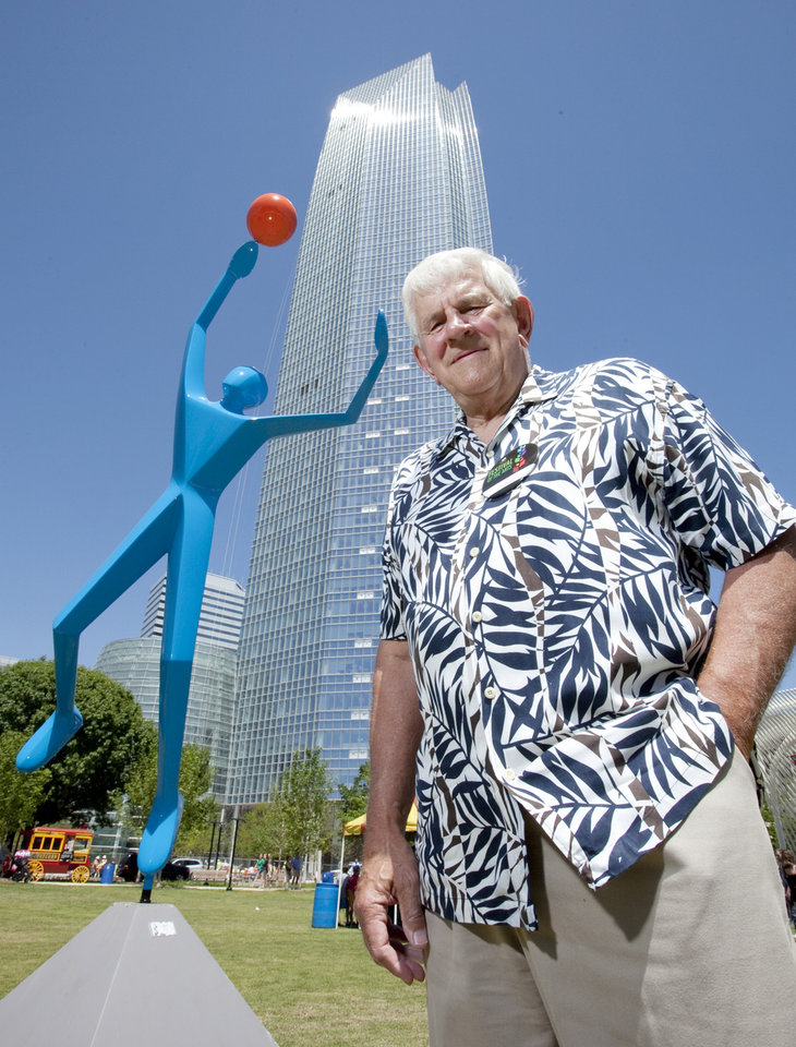 "Sculptor Jim Stewart with Stewart Designs stands next to his sculpture ""Slam Dunk"" at the Festival of the Arts on Friday, April 27, 2012, in Oklahoma City, Okla.  Photo by Steve Sisney, The Oklahoman"