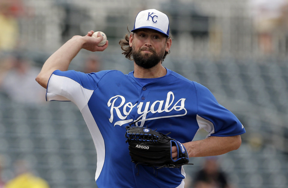 Photo - FILE - In this March 5, 2013, file photo, Kansas City Royals starting pitcher Luke Hochevar throws during an exhibition spring training baseball game against the Oakland Athletics in Surprise, Ariz. All over spring training, there's been an outbreak of wrecked elbows and pained pitchers. Hochevar, a reliable reliever for the Royals, felt a twinge on his next-to-last pitch in a game. An MRI revealed a major tear of the ulnar collateral ligament. (AP Photo/Charlie Riedel, File)