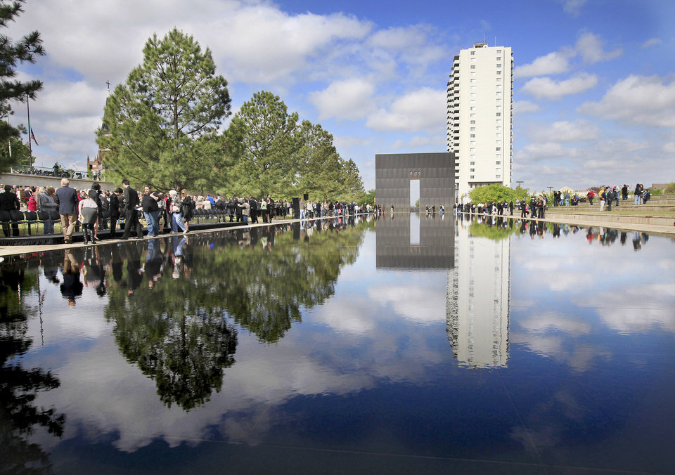 Photo - ALFRED MURRAH FEDERAL BUILDING, BOMBING, CAR, TRUCK, BOMB, EXPLOSION, 15, FIFTEEN, FIFTEENTH, 15TH, YEAR ANNIVERSARY, REMEMBRANCE CEREMONY, ALFRED P. MURRAH FEDERAL BUILDING: People walk to the chair area at the end of the official ceremony to remember and commemorate the 15th anniversary of the bombing  of the Alfred P. Murrah Federal Building. Hundreds, including relatives, friends and co-workers of the 168 people who died in the explosion, attended the 90-minute service at the Oklahoma City National Memorial & Museum on the site where the federal building once stood in downtown Oklahoma City, Monday, April 19, 2010.  Photo by Jim Beckel, The Oklahoman ORG XMIT: KOD