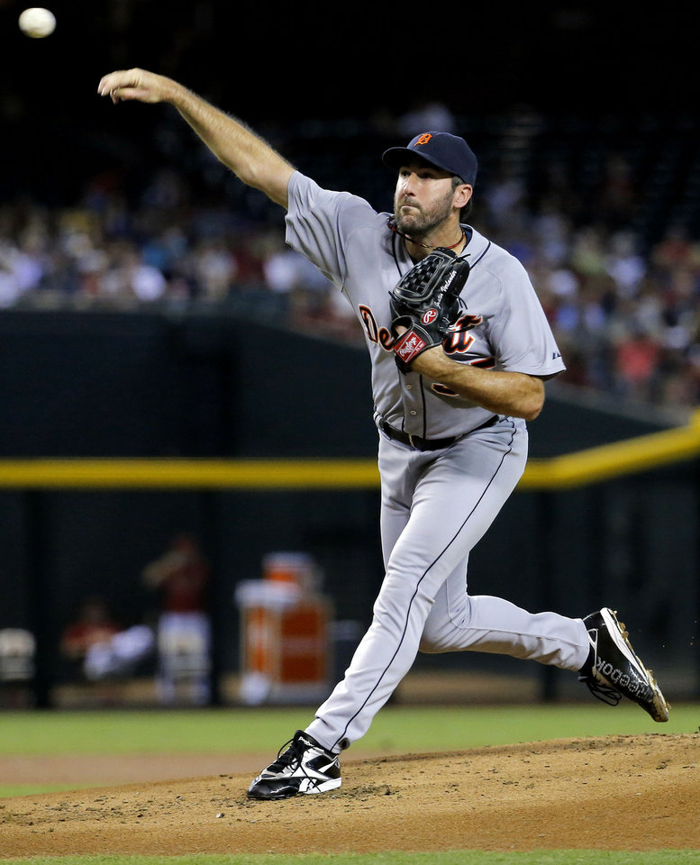 Photo - Detroit Tigers pitcher Justin Verlander throws against the Arizona Diamondbacks during the first inning of a baseball game, Monday, July 21, 2014, in Phoenix.  (AP Photo/Matt York)