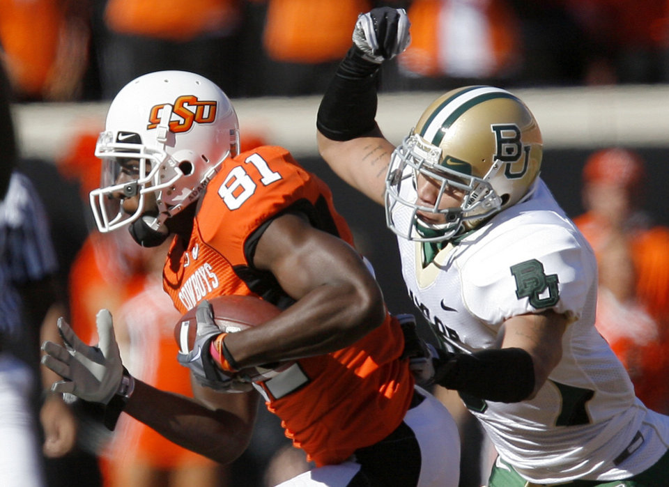 OSU\'s Justin Blackmon gets by Baylor\'s Tim Atchinson during the college football game between the Oklahoma State University Cowboys (OSU) and the Baylor University Bears at Boone Pickens Stadium in Stillwater, Okla., Saturday, Nov. 6, 2010. Photo by Sarah Phipps, The Oklahoman