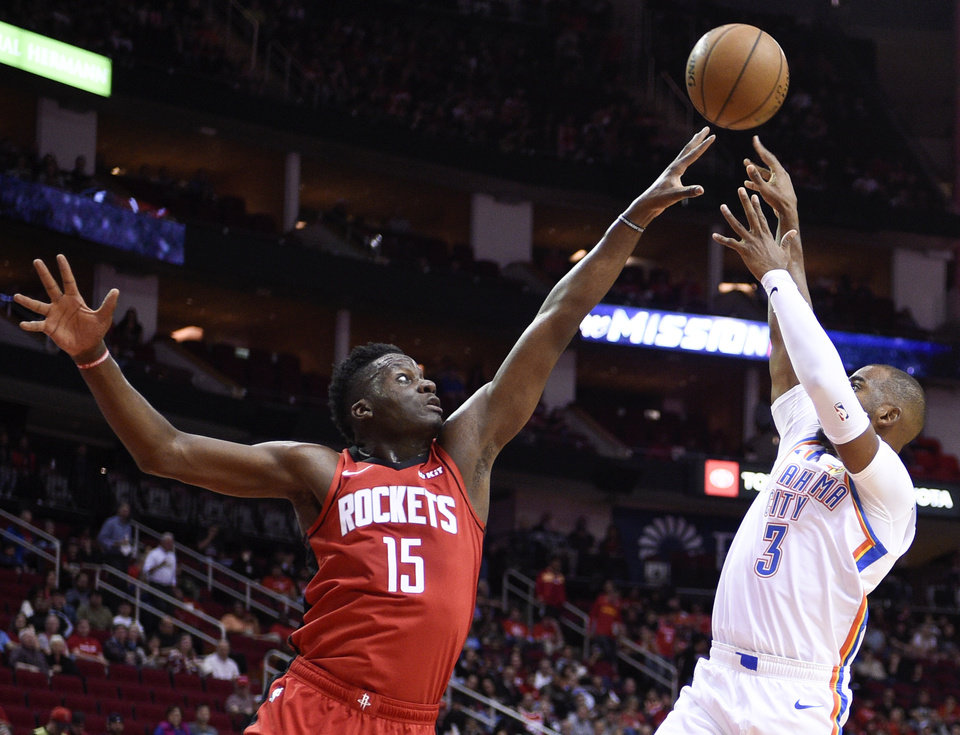 Photo - Oklahoma City Thunder guard Chris Paul (3) shoots as Houston Rockets center Clint Capela defends during the first half of an NBA basketball game, Monday, Oct. 28, 2019, in Houston. (AP Photo/Eric Christian Smith)