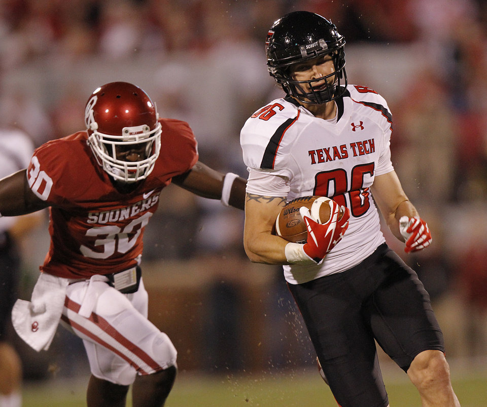 Texas Tech's Alex Torres (86) out runs Oklahoma's Javon Harris (30) for a touchdown during the college football game between the University of Oklahoma Sooners (OU) and Texas Tech University Red Raiders (TTU) at the Gaylord Family-Oklahoma Memorial Stadium on Saturday, Oct. 22, 2011. in Norman, Okla. Photo by Chris Landsberger, The Oklahoman