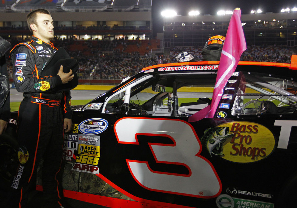 Austin Dillon stands during the national anthem before the NASCAR Dollar General 300 Nationwide Series auto race in Concord, N.C., Friday, Oct. 12, 2012. (AP Photo/Chuck Burton)