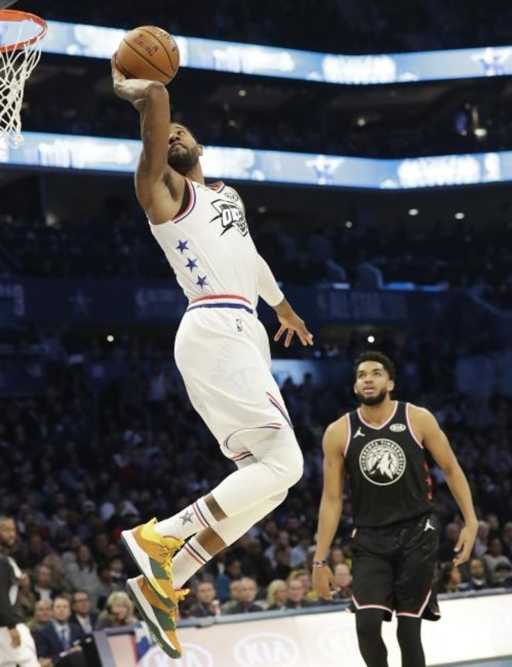 Photo -  Paul George's reverse-360 Statue of Liberty dunk was one of the top highlights of Sunday's NBA All-Star Game in Charlotte, N.C. [AP Photo/Chuck Burton]