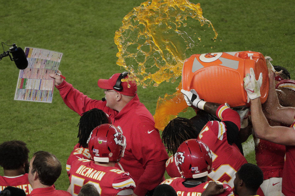Photo - Kansas City Chiefs' players pour a cooler of Gatorade on head coach Andy Reid, during the second half of the NFL Super Bowl 54 football game against the San Francisco 49ers, Sunday, Feb. 2, 2020, in Miami Gardens, Fla. The Chiefs' defeated the 49ers 31-20. (AP Photo/Charlie Riedel)