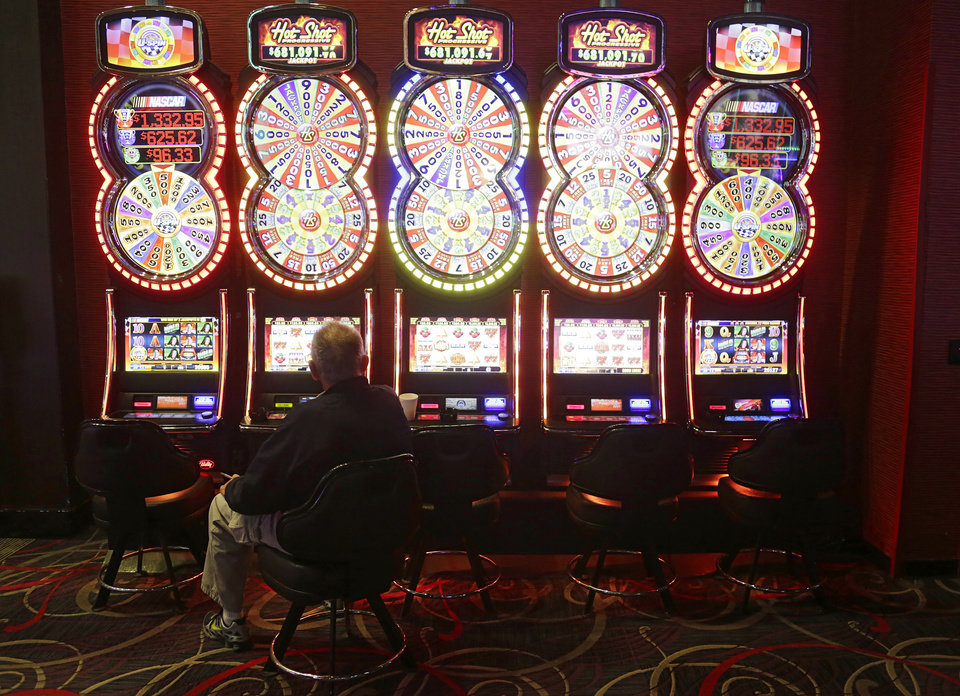 Photo -  A guest plays slot machines at an Oklahoma casino Jan. 6, 2016. [MIKE SIMONS/Tulsa World file]