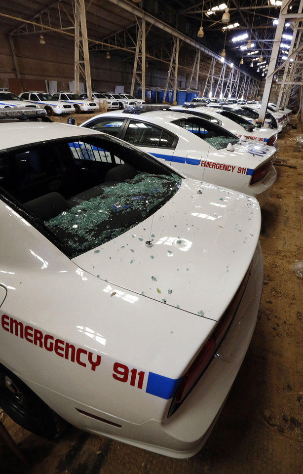 Photo - Jackson, Miss., police cruisers await additional evaluation Tuesday, March 19, 2013 at a downtown warehouse following extensive hail damage Monday afternoon. Shattered front and back windshields, body damage and even some with interior damage from the accompanying rain forced the city to pull at least 25 vehicles from duty. Authorities in central Mississippi say it's too early to know exactly how many structures or vehicles were damaged, but it appears to be widespread in parts of Jackson and its suburbs. Hail as big as baseballs pounded some spots, and there were reports of even bigger hail in a few places. (AP Photo/Rogelio V. Solis)