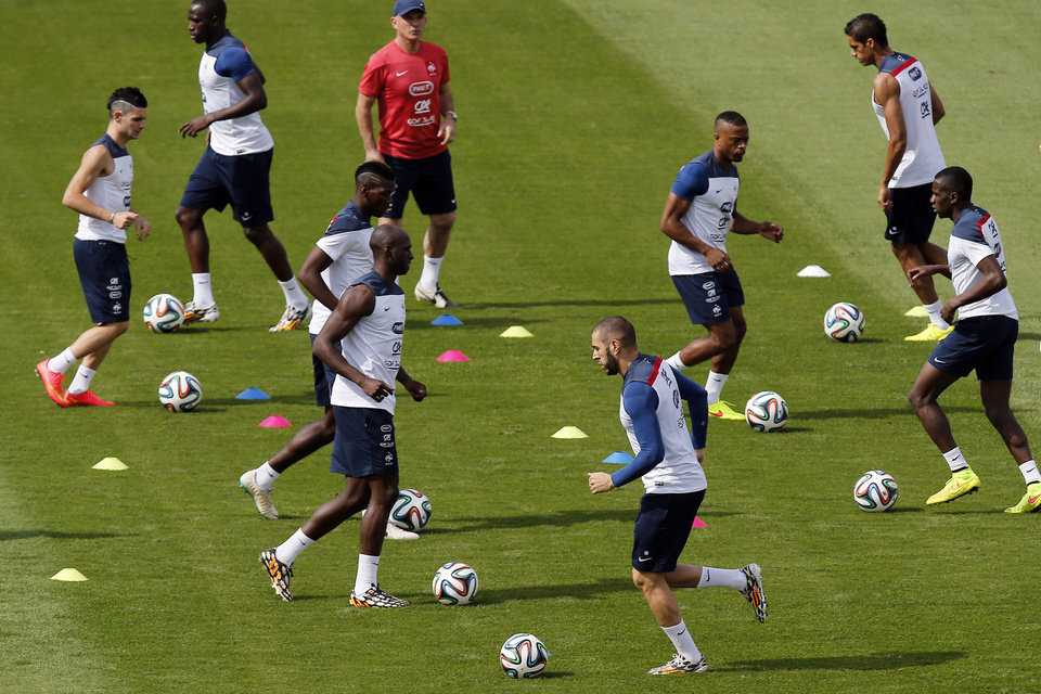 Photo - France's players run on the field during a training session at Santa Cruz stadium in Ribeirao Preto, Brazil, Saturday, June 28, 2014. France will face Nigeria on Monday in the round of 16 at the World Cup. (AP Photo/David Vincent)