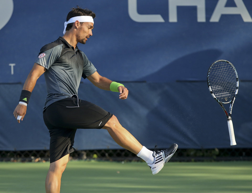 Photo - Fabio Fognini, of Italy, kicks his racket after a point against Adrian Mannarino, of France, during the second round of the 2014 U.S. Open tennis tournament, Friday, Aug. 29, 2014, in New York. (AP Photo/John Minchillo)